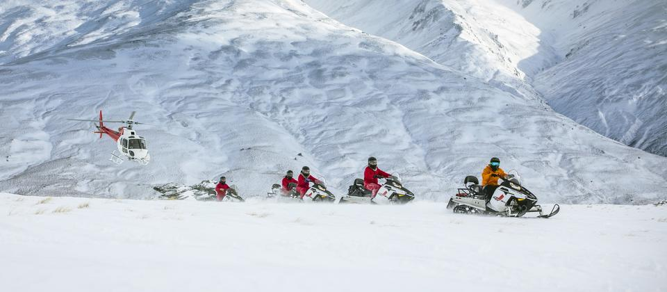 Guided snowmobile tours across Garvie Plateau, Queenstown
