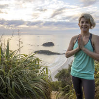 Practice your sun salutations on Mount Manganui