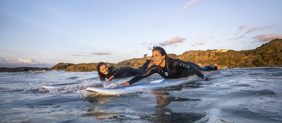 Catching a wave in Raglan