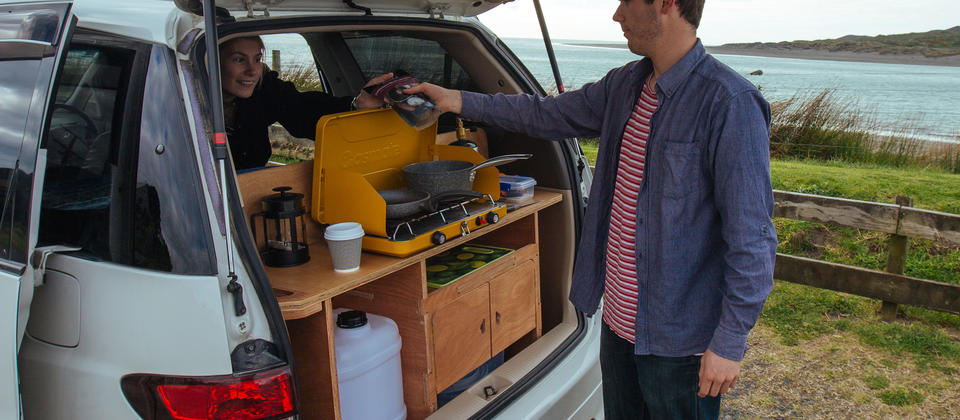 The boot lid doubles as a shelter for cooking in the fully equipped Mode Camper