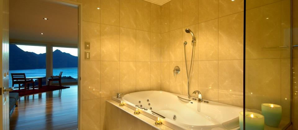 Private ensuite with spa bath and separate shower