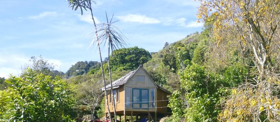 The Hexagon is perched up on bush clad hills overlooking Woodpecker Bay