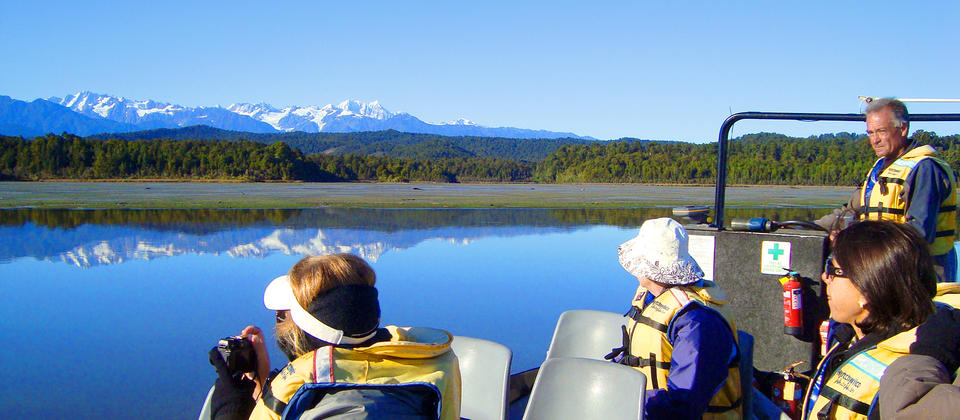 Amazing reflections of the Southern Alps on Okarito Lagoon