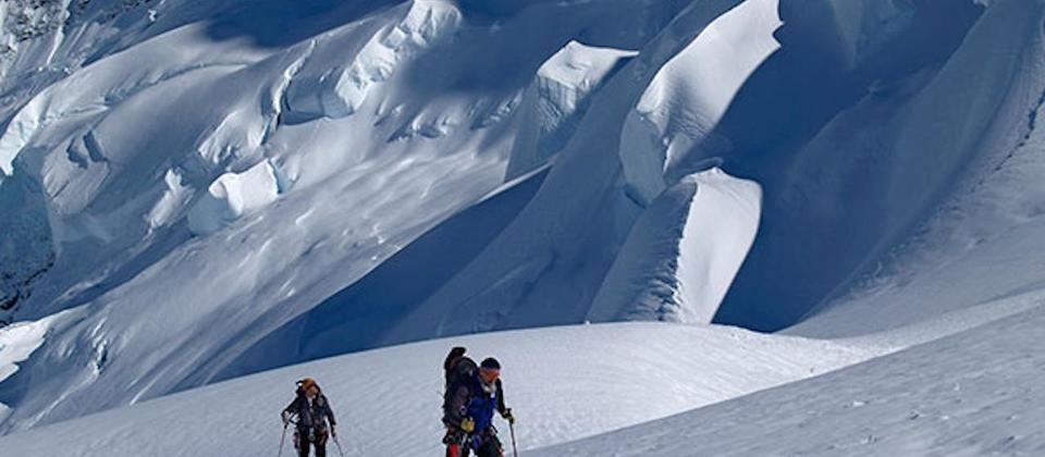 Alpine ski tourers ascend the Brodrick Ramp at the head of the Tasman Glacier