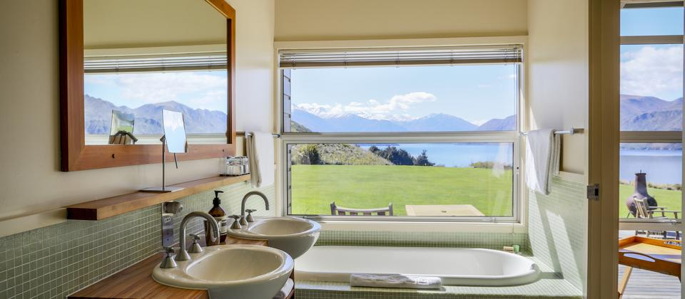 Whare Kea Lodge Deluxe Bathroom with views towards the mountains over Lake Wanaka.jpg