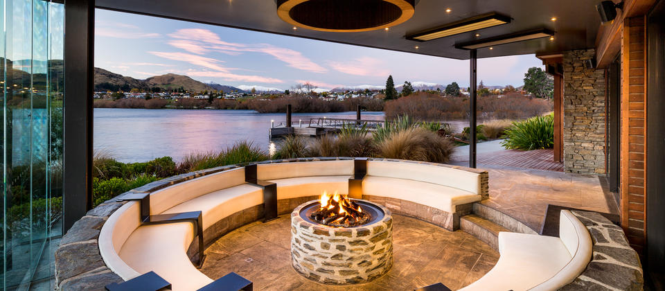 Relax with a drink in front of the fire in our decadent Pinot Pit with sweeping views of Lake Wakatipu.