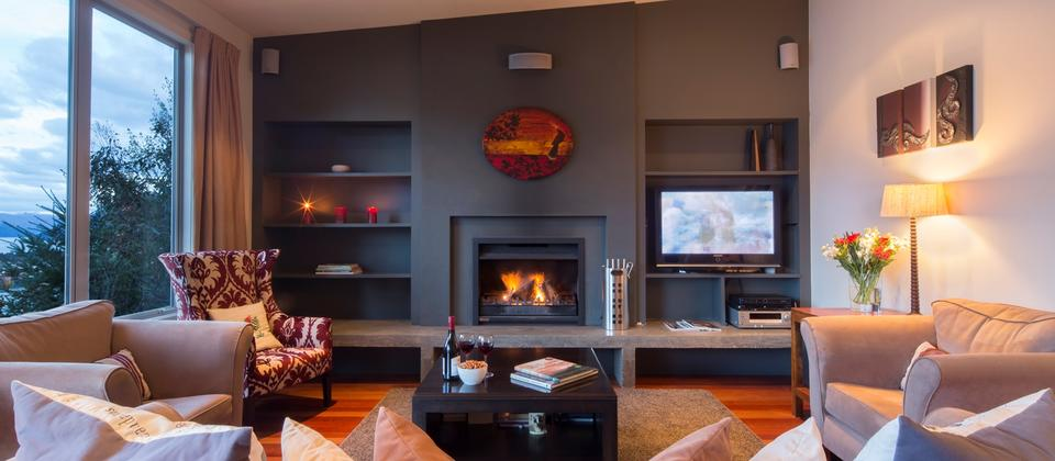 comfortable lounge area with an open fireplace; the perfect atmosphere after a day on the slopes