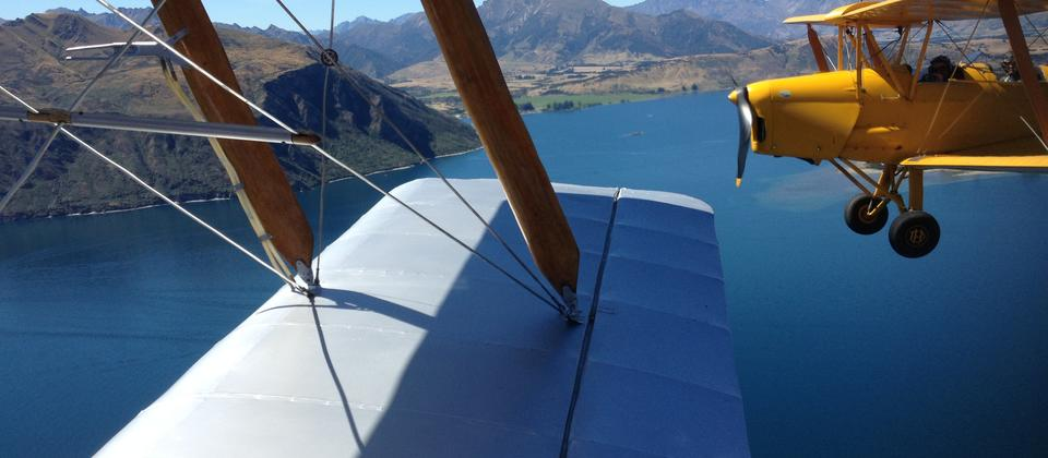 Looking down the wing of your vintage aircraft you see your partner traversing the great blue sky with you