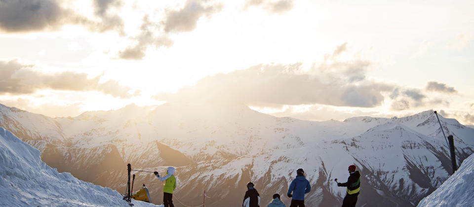 Night Ski transfers to Coronet Peak - Friend enjoying sunset on the slopes