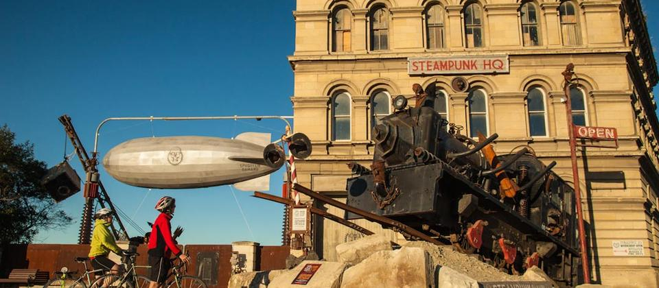 Cyclists checking out the Steampunk in Oamaru on Adventure South's Alps to Ocean tour