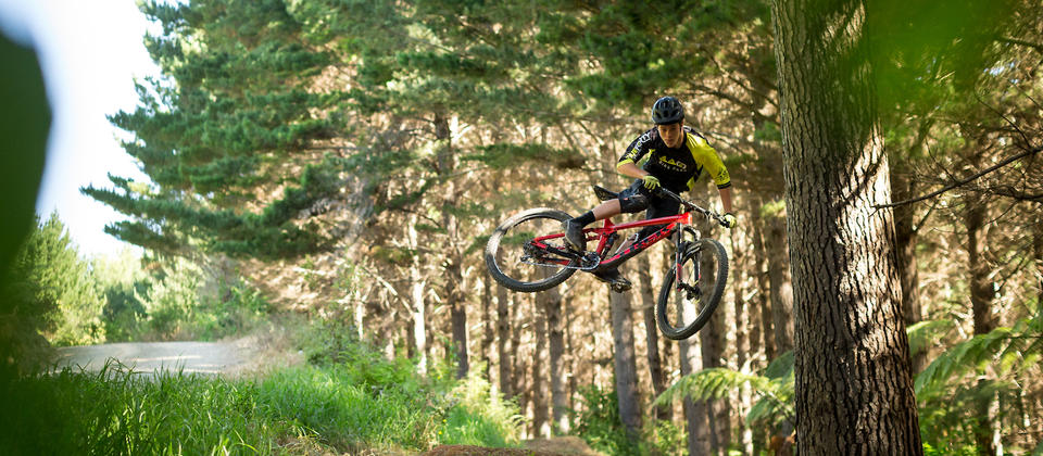 440 rider Matt Berry launching a jump on Pretty Fly trail