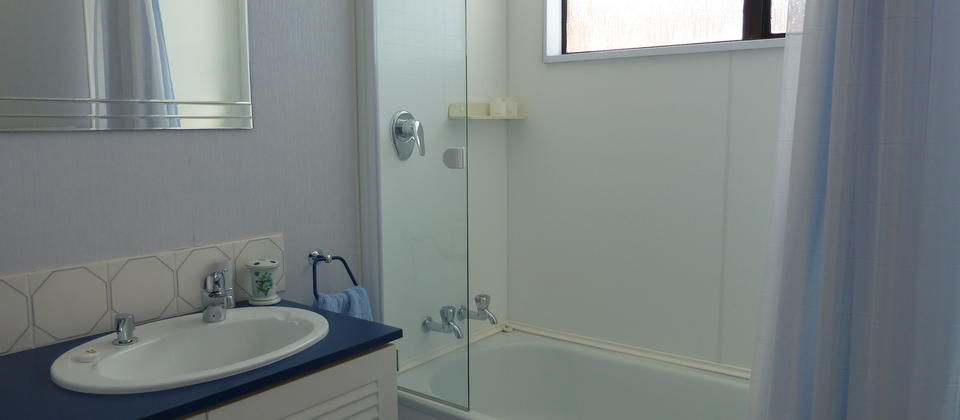 Shared bathroom and shower. There is an adjacent separate toilet.