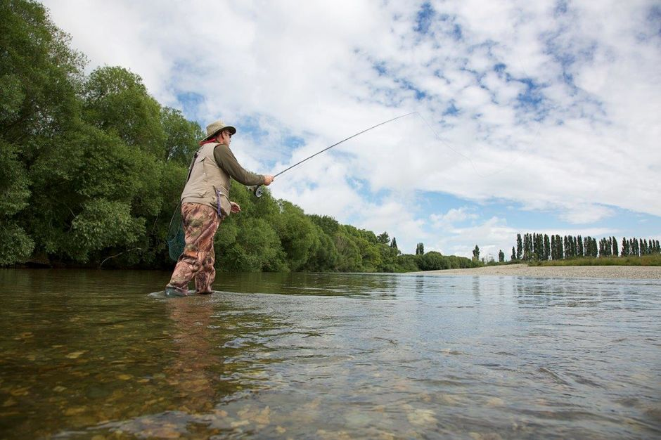 Fishing the Mataura River, Gore District. World famous for brown trout fly fishing.
