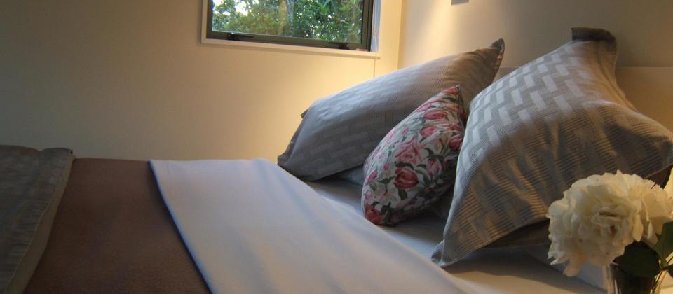 Queen beds with high quality linen, duvets and wool blankets.  Listen to the stream from one of the windows.