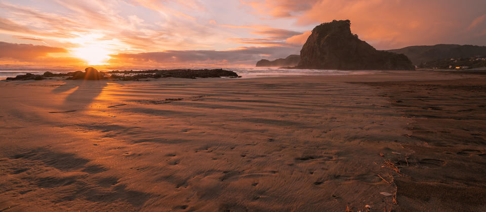 Sunset over Piha Beach