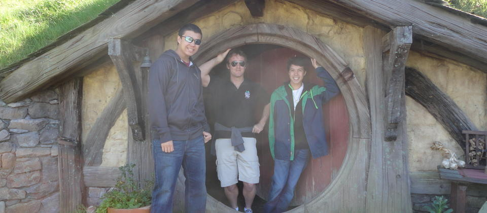 Posing at Hobbiton with the group