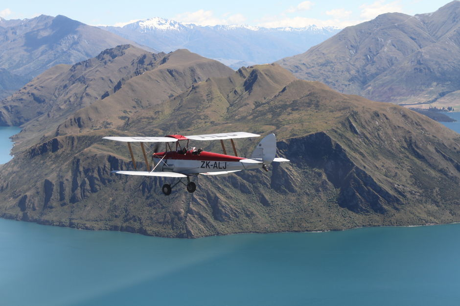 ZK-ALJ takes a flight over the lake at Wanaka.