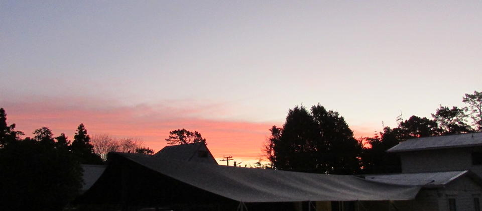 Sunset Over the 10-bed Dorm and Outdoor Eating Area