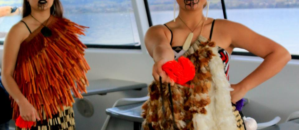 Learn to work the poi on the Taurikura Maori Cultural Scenic Cruise Experience