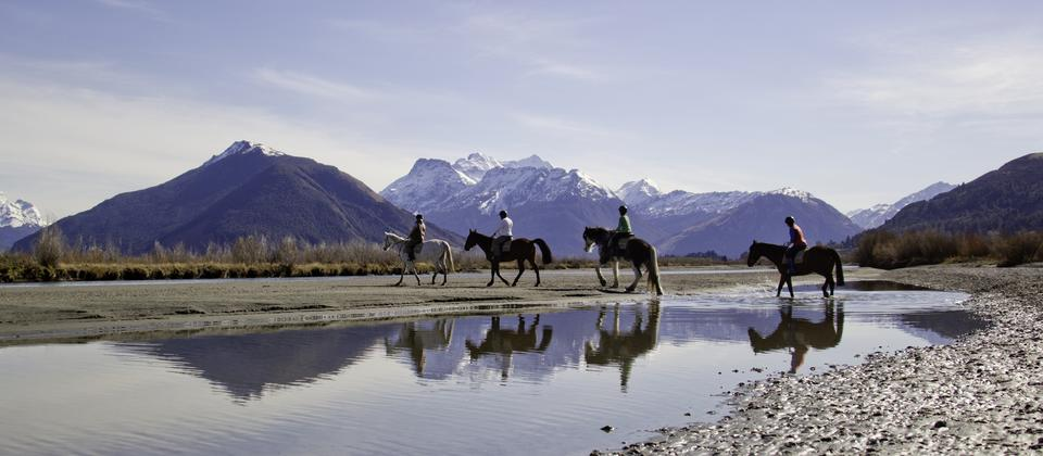 Enjoy a gentle horse ride with breathtaking views of Mt Alfred and other stunning Dart River Valley backdrops.