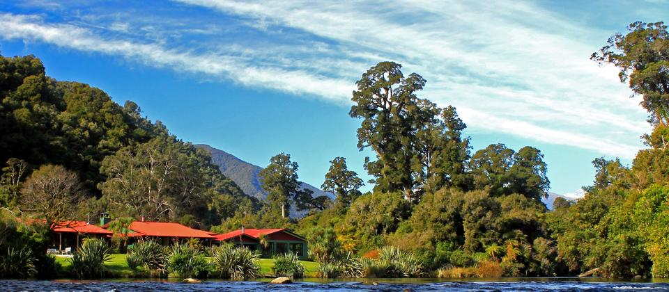New Zealand's premier nature lodge sits alongside the Moeraki River surrounded by Te Wahipounamu World Heritage Area.