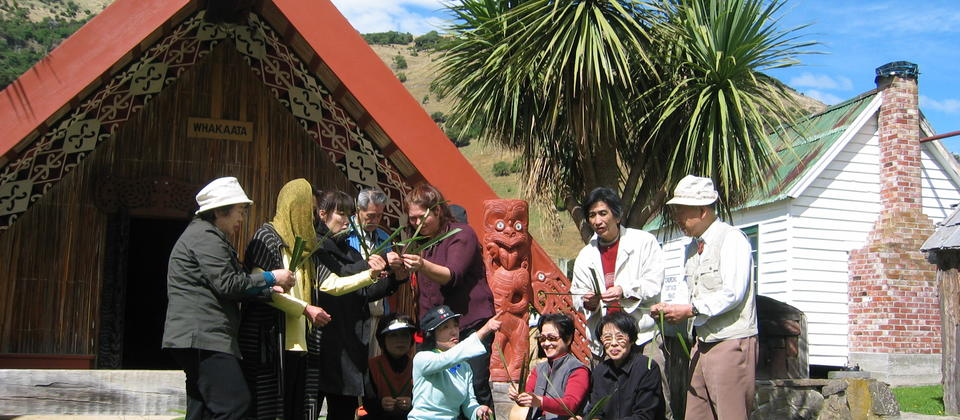 Group enjoy weaving at Okains Bay