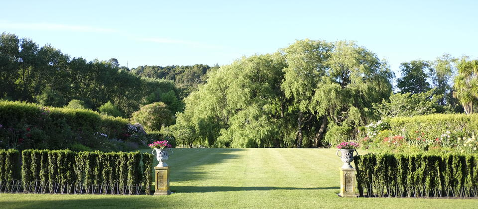 The Formal Lawns and boarders creating a classic English garden in New Zealand