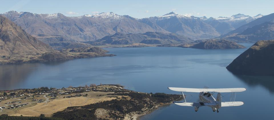 The majestic expanse of Lake Wanaka as our Waco aircraft soars above it
