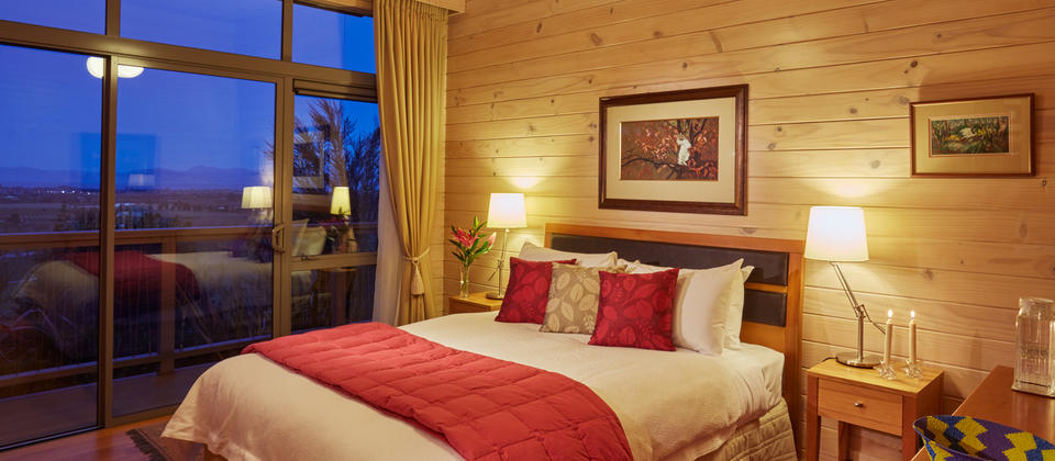 awatea-guest-house-bay-view-suite-bnb-bedroom-at-dusk.jpg