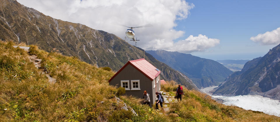 Climb a mountain, explore a glacier, overnight in a historic hut and feel the moods of the mountains.