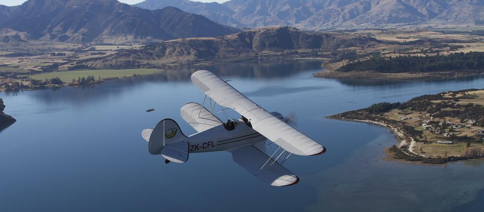 Soaring over Lake Wanaka in this gorgeous 1930s biplane which seats 2 passengers in the front seat