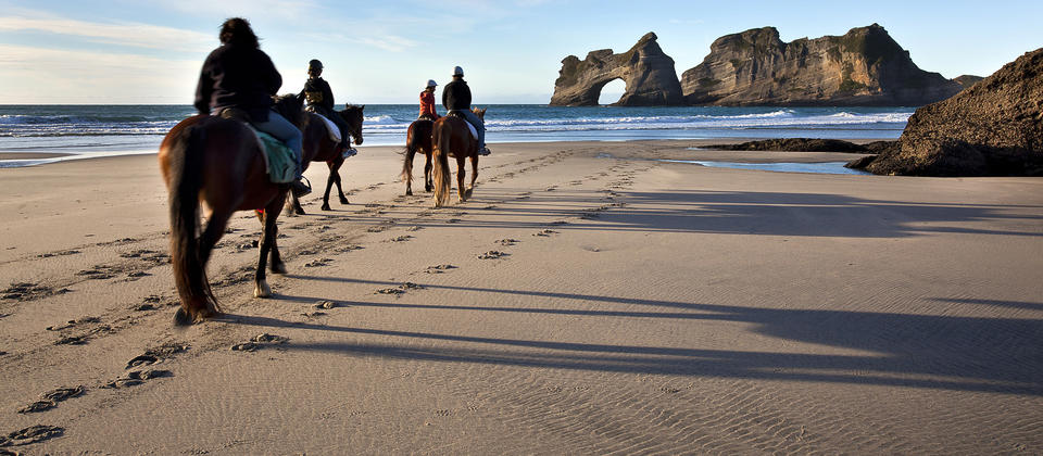 Wharariki beach horse riding.jpg