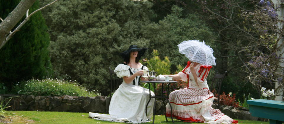 Tea party in costume circa 1900