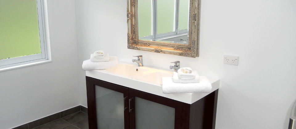 Double vanity in the spacious upstairs ensuite bathroom.