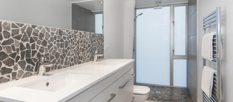 Master bedroom ensuite with double shower heads and vanities
