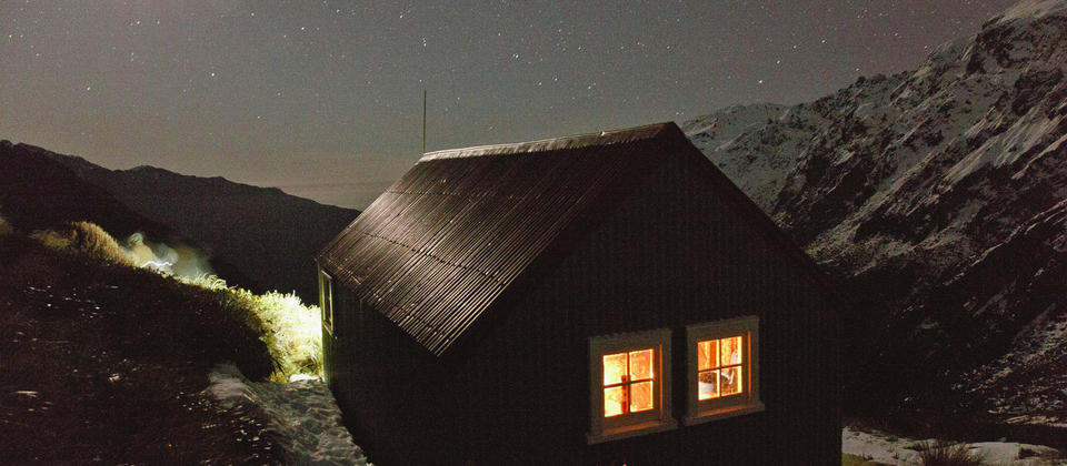 On a clear evening, enjoy the mountains to sea vista and crystal clear air while inside the historic hut is bathed in candlelight.
