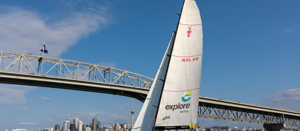 America's Cup Yacht sailing under the Auckland Harbour Bridge
