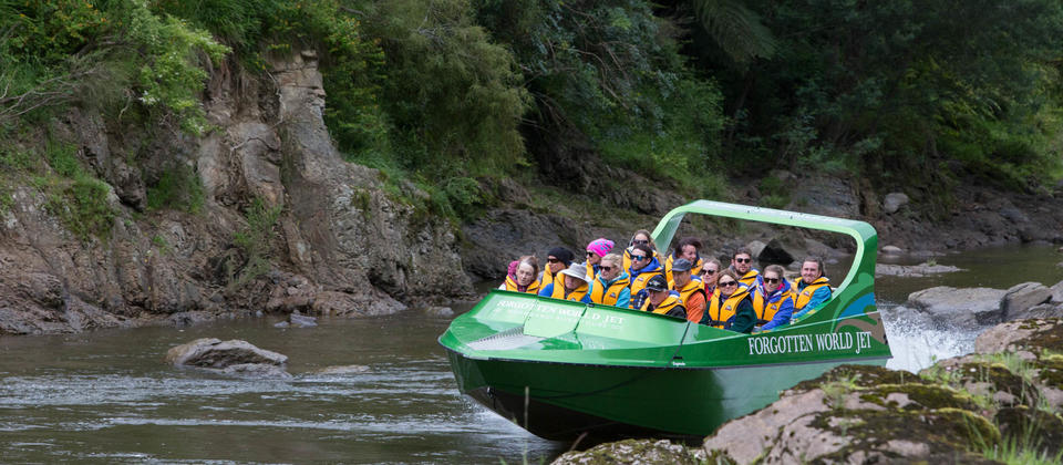 Enjoying the Whanganui River in the comfort of the Forgotten World Jet Boat