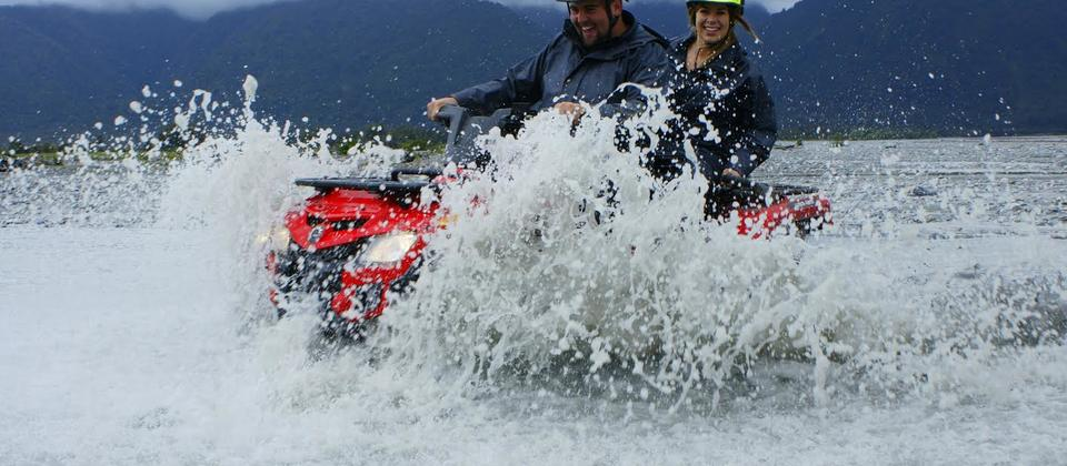 Splashing through the mighty Waiho River.