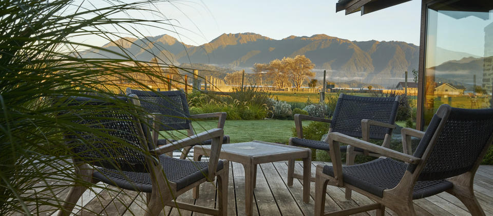 Sun deck with uninterrupted views of Fiordland Mountains and Lake Te Anau.