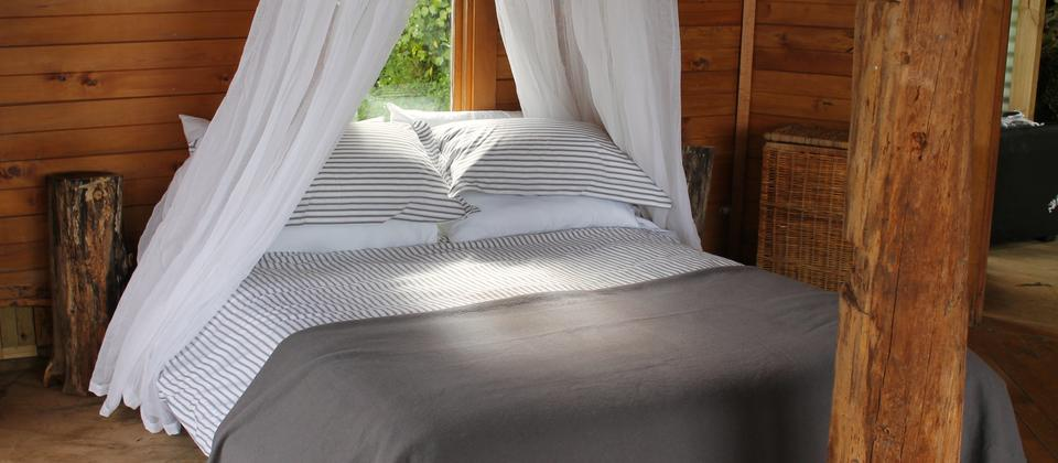 A luxurious bed, with pure cotton linen and duvet and bedding offer a delicious nights sleep.