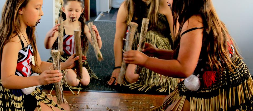 Participate in traditional Maori games on the Taurikura Maori Cultural Scenic Cruise Experience