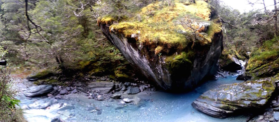 Huge rocks seen in the crystal clear waters of the Rob Roy Glacier Stream.