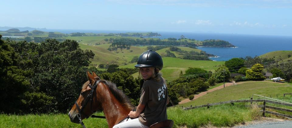 Lovely views and a smily happy young rider.
