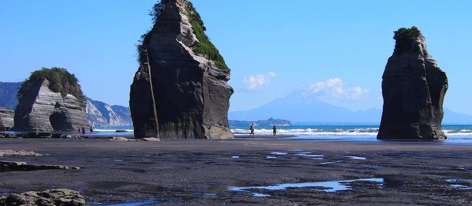 Three sisters at Tongaporutu with Mt Taranaki in the distance