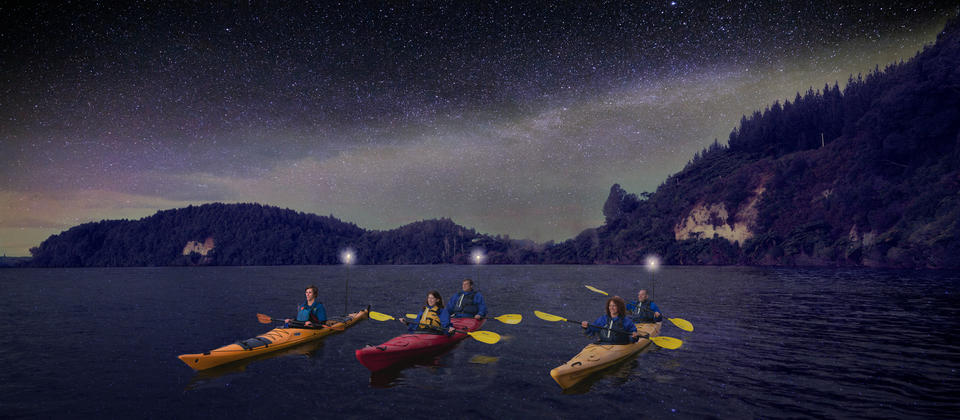 Kayaking under the night sky