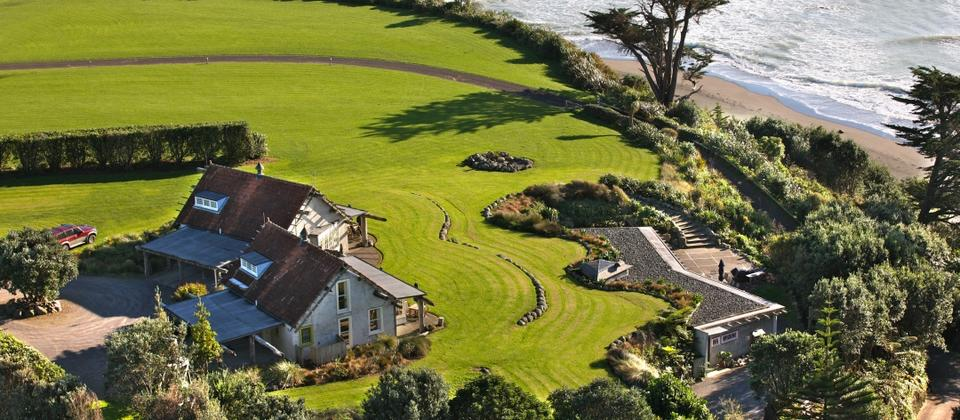 Set in farmland with magnificent sea views