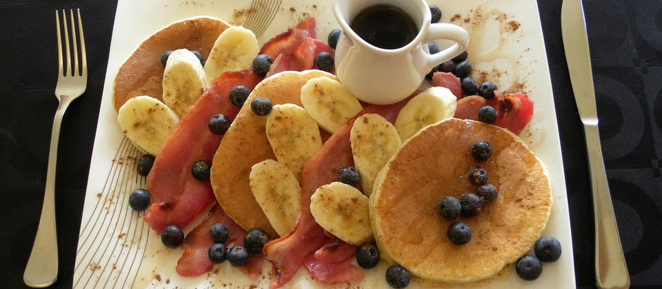 Pancakes streaky bacon blueberries and maple syrup