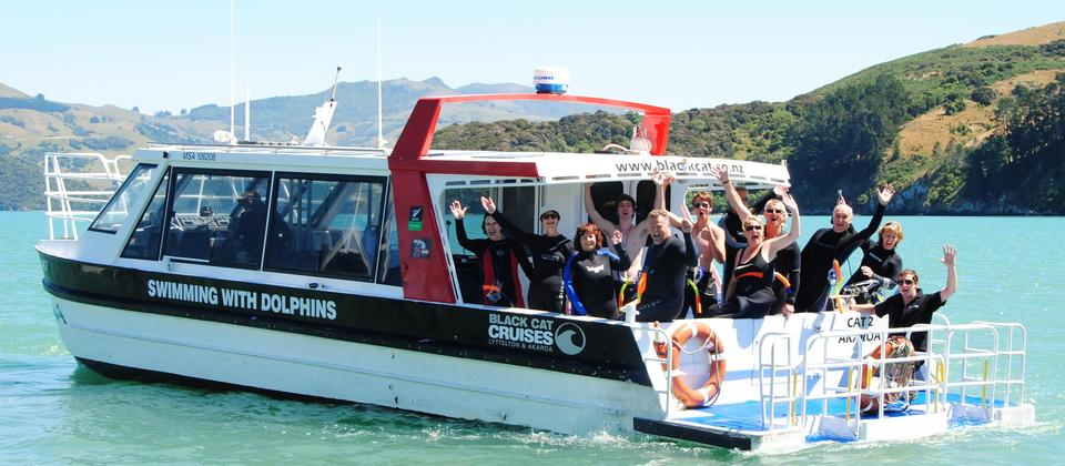 Happy Customers heading out to swim with dolphins in Akaroa