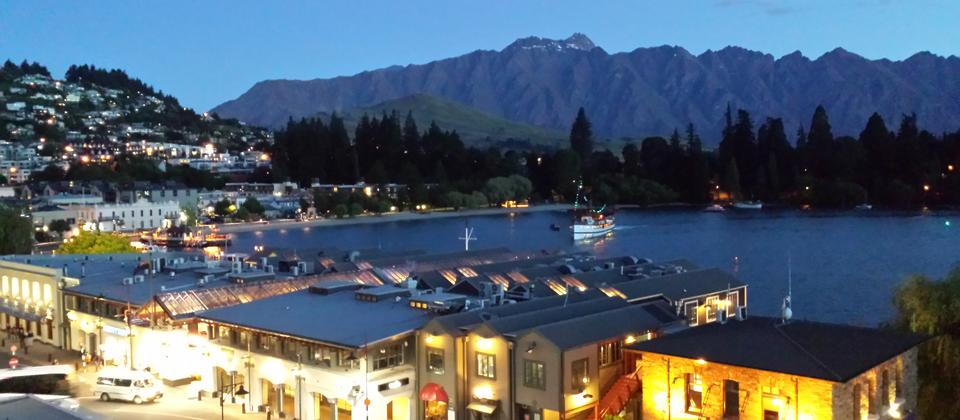 Evening lights Queenstown & the Remarkables mountains.